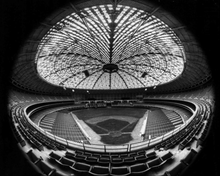 """The Houston Astrodome in 1965, seen through a fisheye lens. The Houston Astros played their first game in the stadium on April 9, 1965. On Saturday, a """"yard sale"""" and auction got underway for anyone wanting to buy a memento from the stadium once dubbed the """"Eighth Wonder of the World."""""""