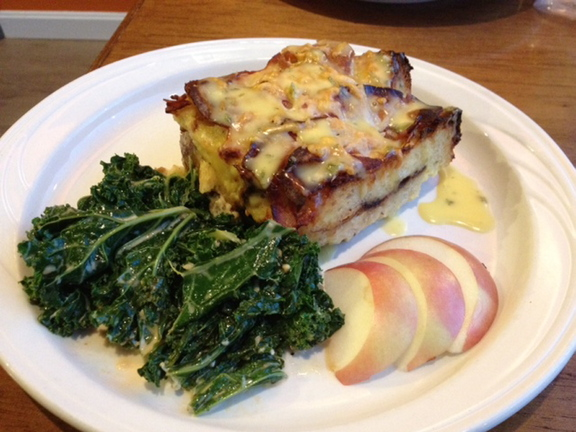 Leaven's bread pudding entree is served with the vegetable of the day and apple slices.