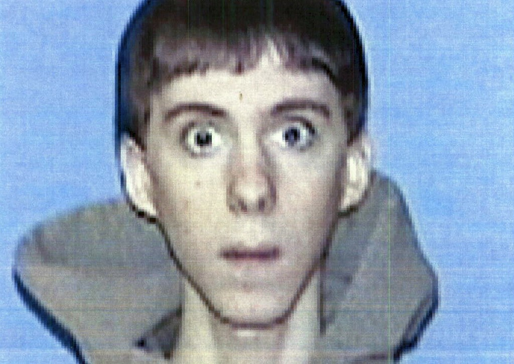 This undated file identification photo released Wednesday, April 3, 2013 by Western Connecticut State University in Danbury, Conn., shows former student Adam Lanza, who authorities said opened fire inside the Sandy Hook Elementary School in Newtown, Conn., on Friday, Dec. 14, 2012, killing 26 students and educators. Investigators released a report on the shooting Monday, Nov. 25, 2013, by the prosecutor overseeing the probe, State's Attorney Stephen Sedensky III.