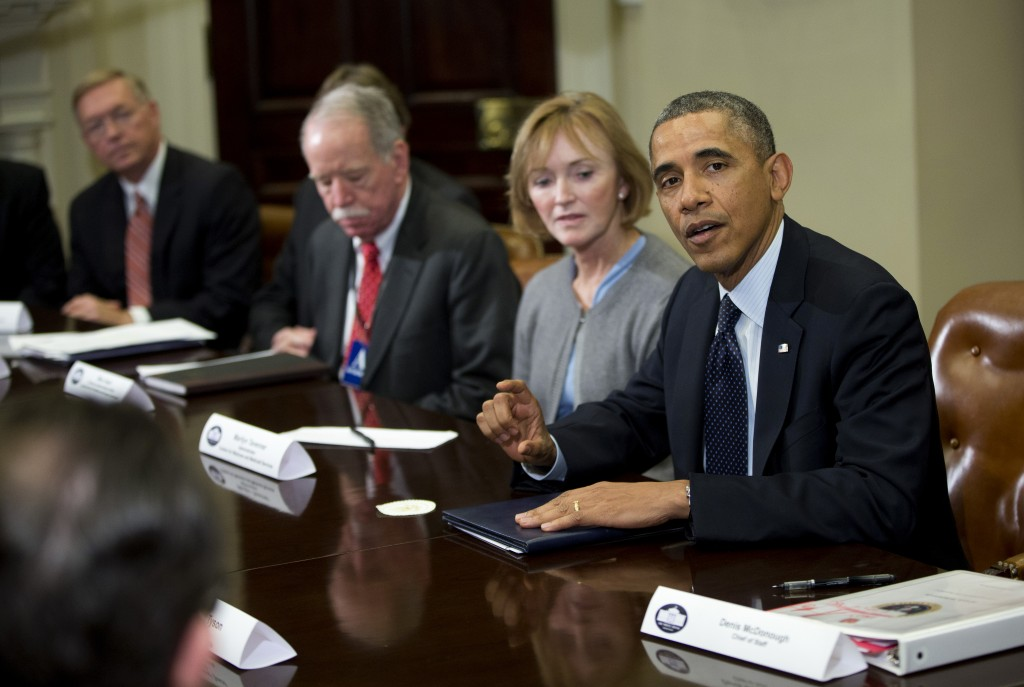 "President Obama makes a statement before the start of a ""brainstorming"" meeting with representatives of health insurance companies Friday at the White House."