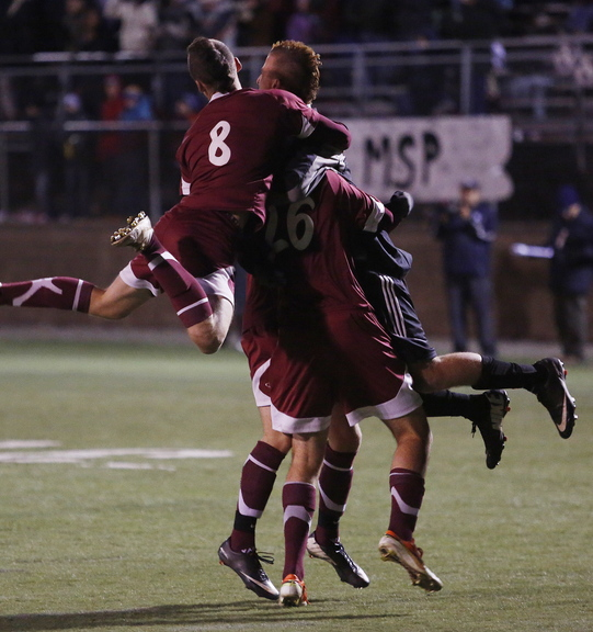 Greely High players celebrate a 1-0 win over Camden Hills on Saturday in the Class B boys' soccer state championship game at Hampden Academy.