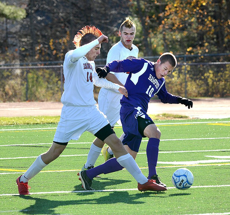 Scarborough's Max Ornstein, left, and Hampden Academy's Benjamin Foster fight for the ball during the Class A boys' soccer state championship on Saturday. BoysAsoccer
