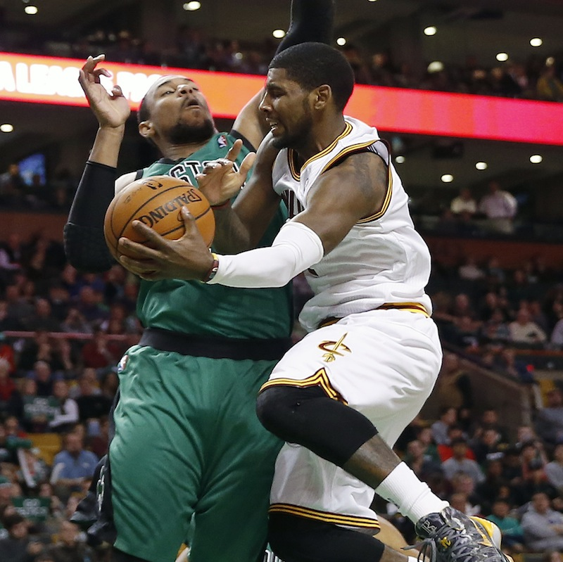 Boston Celtics' Jared Sullinger, left, blocks Cleveland Cavaliers' Kyrie Irving in the second quarter of an NBA basketball game in Boston, Friday, Nov. 29, 2013.