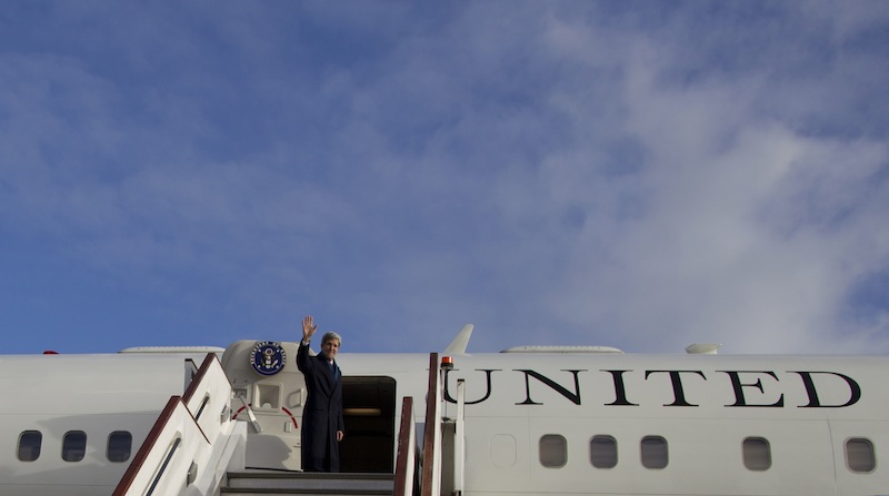 Secretary of State John Kerry turns and waves as he boards his aircraft at London's Stansted Airport, Monday, Nov. 25, 2013, en route to Washington. While in London Kerry had meetings with Libyan's Prime Minister Ali Zeidan and British Foreign Secretary William Hague. Prior to London, Kerry was in in Geneva, Switzerland, for the Iran nuclear talks. European Union sanctions against Iran could be eased as soon as December, officials said Monday, after a potentially history-shaping deal that gives Tehran six months to increase access to its nuclear sites in exchange for keeping the core components of its uranium program.