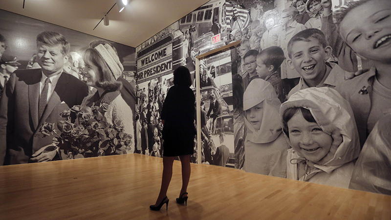 In this Wednesday, May 22, 2013 file photo, a woman looks a mural of photos in the exhibit