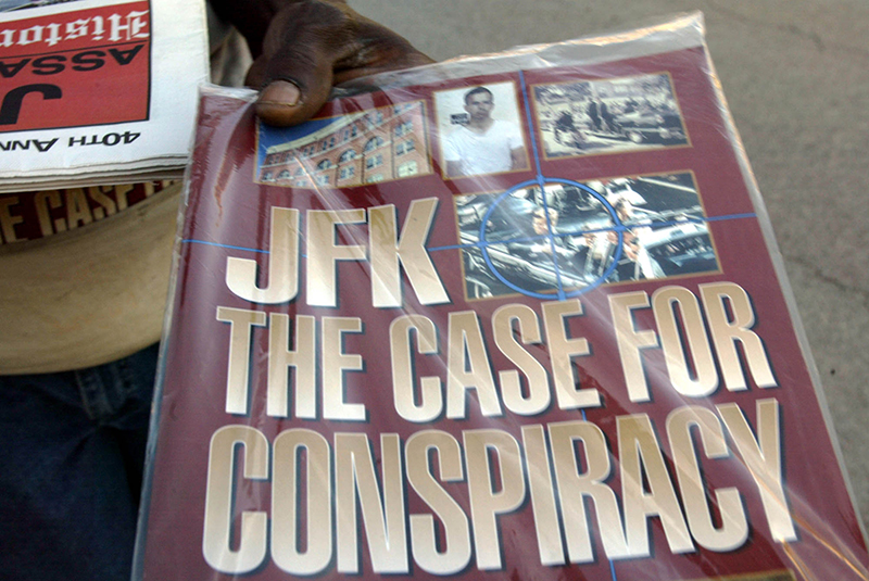 In this Saturday, Nov. 8, 2003 file photo, a vendor holds up a magazine-style publication titled
