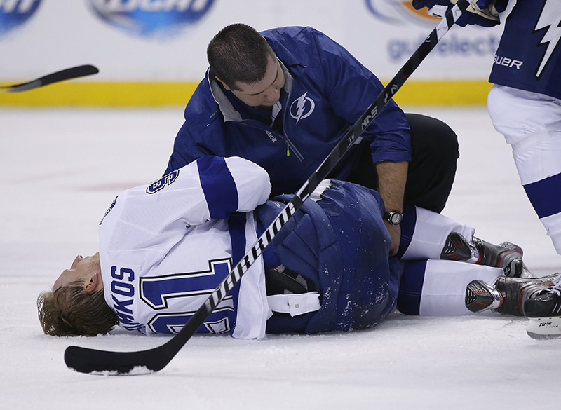 Tampa Bay Lightning center Steven Stamkos is attended to on the ice after banging into the goalpost during the second period of an NHL hockey game against the Boston Bruins in Boston Monday, Nov. 11, 2013. Stamkos was taken off the ice on a stretcher after the play. (AP Photo/Elise Amendola) TD Garden