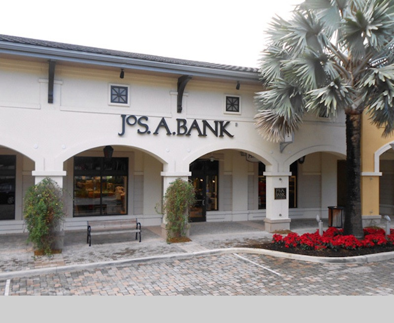 This undated photo provided by JoS. A. Bank, shows a JoS. A. Bank store at the Shops at Midtown Miami in Miami, Fla. As of Tuesday, Nov. 26, 2013, Men's Wearhouse is turning the tables on its recent pursuer, offering to buy Jos. A. Bank for approximately $1.54 billion. The offer comes less than two weeks after Jos. A. Bank withdrew its $2.3 billion bid for its rival.