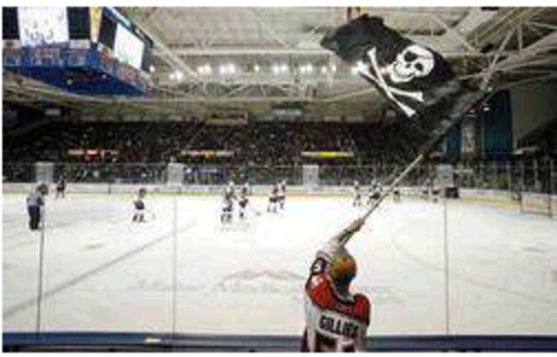Dan Bailey of Yarmouth waves the Jolly Roger during a game between the Portland Pirates and Manchester Monarchs at the Cumberland County Civic Center in 2010. The arena's trustees and the team's owners should resume talks to resolve a stalemate over the Pirates' lease.