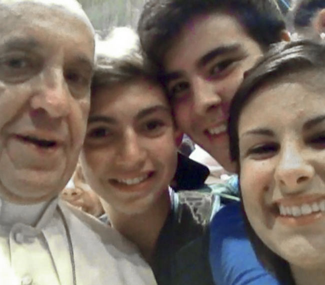 """Pope Francis has a """"selfie"""" taken inside St. Peter's Basilica with youths from the Italian Diocese of Piacenza and Bobbio who came to Rome for a pilgrimage."""