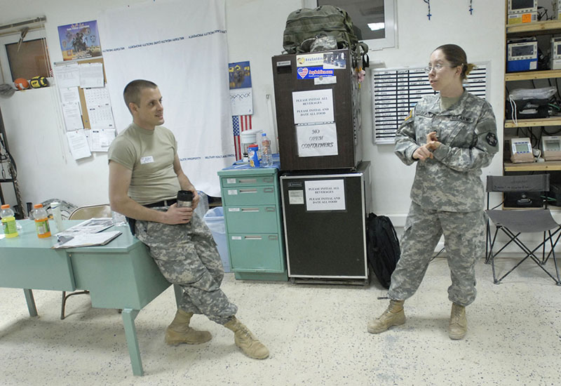 Shawn Patrick Ouellette/Staff Photographer Sgt. Tim Verreault and Spc. Jessica Verreault of Auburn, talk during a slow moment in the Emergency Medical Treatment Unit Wednesday night at the Army Reserve's 399th Combat Support Hospital.
