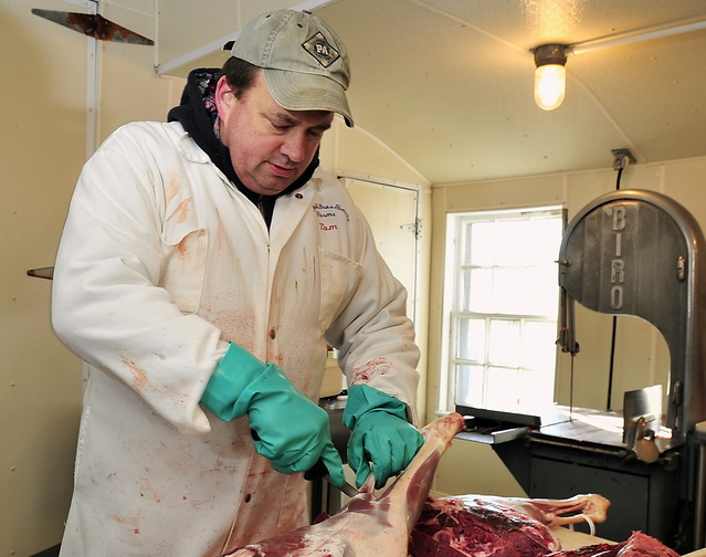 Tom Blaisdell carries on a family tradition as he carves a hunter's deer at York's Blaisdell Bros. Family Farm, which every autumn becomes one of southern Maine's most productive deer-processing facilities.