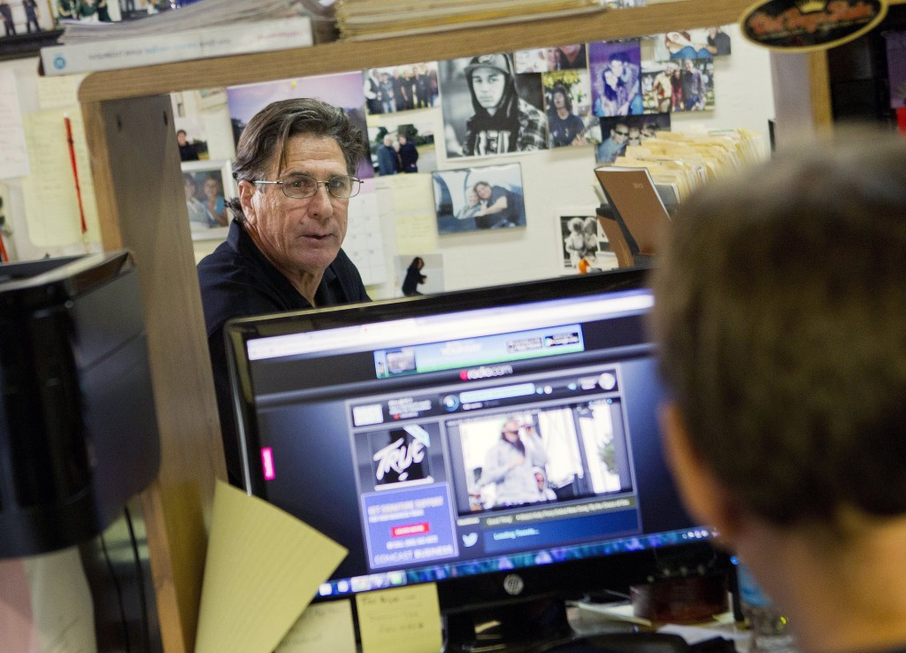 "Bill Moore runs his business from the garage of his home. He calls himself a ""digital dinosaur"" but recently he opened a PayPal account."