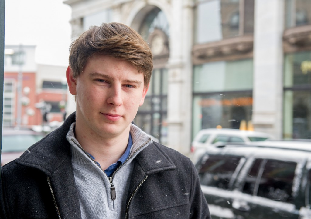 "Bart Murawski, shown outside a coffee shop in Troy, N.Y., says, ""I'm leery of everybody. Caution is always a factor."" A recent AP-GfK poll found that Americans are suspicious of each other in everyday encounters. Less than a third expressed a lot of trust in clerks who swipe their credit cards, drivers on the road, or people they meet when traveling."