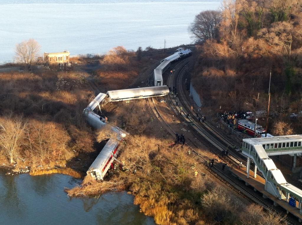 Cars from a Metro-North passenger train are scattered after the train derailed in the Bronx borough of New York on Sunday.