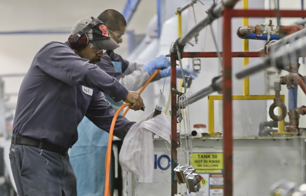 Employees at Sheffield Platers Inc. work on the factory floor in San Diego in October.