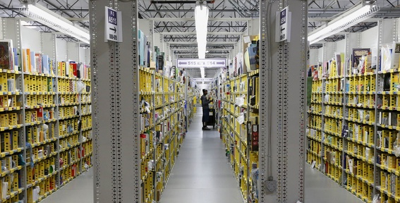 "An Amazon.com employee stocks a shelf at an Amazon.com Fulfillment Center on ""Cyber Monday"" the busiest online shopping day of the holiday season, Monday in Phoenix."