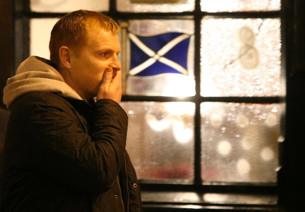 Celtic manager Neil Lennon gestures after laying flowers at the scene of the helicopter crash at the Clutha Bar in Glasgow, Scotland, on Monday. The crash of a police helicopter crash killed nine people and injured more than two dozen.