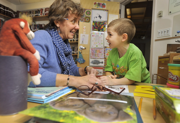 At top, teacher Abby Snyder works with patient Carter Blanche, 6, of Augusta, during a recent study session in her office at Maine Medical Center's pediatric ward in Portland. Above, Snyder helps Carter with his writing skills.