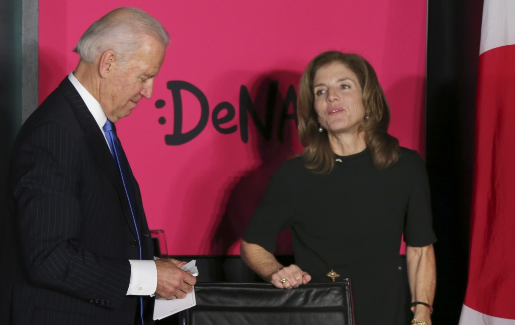 U.S. Vice President Joe Biden talks with U.S. Ambassador to Japan Caroline Kennedy during his tour to DeNA Co. Ltd, a global Internet company providing Web services for mobile devices and PCs, in Tokyo on Tuesday.