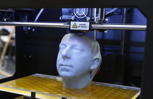 A 3-D printer, such as this one fabricating a likeness of a head, can also be used to produce a working plastic gun that can slip past metal detectors and X-ray machines.