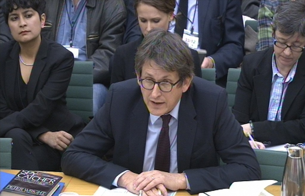 """Editor of The Guardian newspaper Alan Rusbridger gives evidence to the Commons Home Affairs Committee hearing on counter-terrorism at Portcullis House, central London, Tuesday, Dec. 3, 2013. Alan Rusbridger has been questioned by Parliament's home affairs committee as part of a session on counter-terrorism, following The Guardian's publishing of a series of stories based on Edward Snowden's leaks disclosing the scale of surveillance by spy agencies in the United States and Britain. The editor of The Guardian says his newspaper has published just 1 percent of the material it received from former National Security Agency contractor Snowden and """"made very selective judgments"""" about what to publish and had not revealed any intelligence staffers' names. He said: """"We have published no names and we have lost control of no names."""" Government and intelligence officials have said the leaks compromised British security and aided terrorists."""