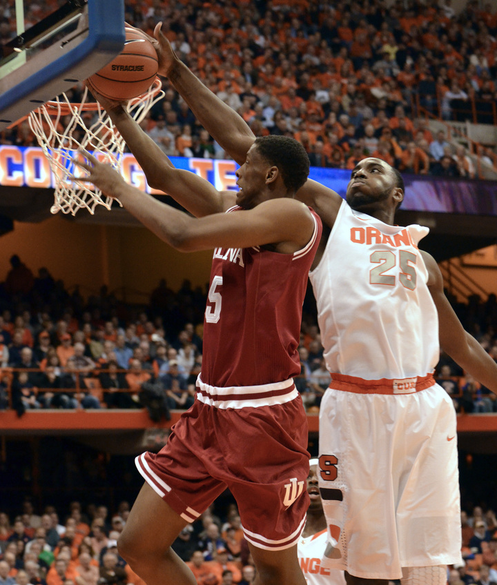Syracuse's Rakeem Christmas rejects a shot by Indiana's Troy Williams in Tuesday night's game at Syracuse, N.Y. The Orange improved to 8-0 with a 69-52 win.