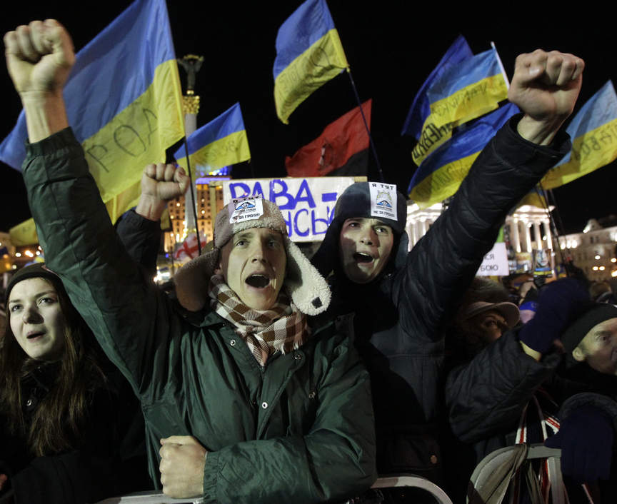 Protesters shout slogans during a rally at Independence Aquare in Kiev, Ukraine, on Tuesday after a no-confidence vote in the country's parliament failed.