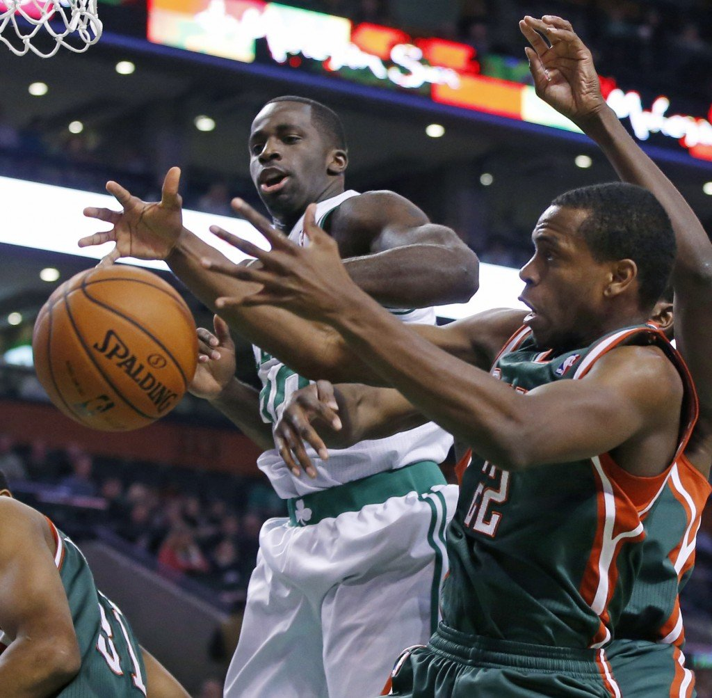 Celtics power forward Brandon Bass, middle, fights for a rebound with Milwaukee Bucks power forward Khris Middleton (22) as forward John Henson (31) ducks down, at left, in the first half in Boston on Tuesday.