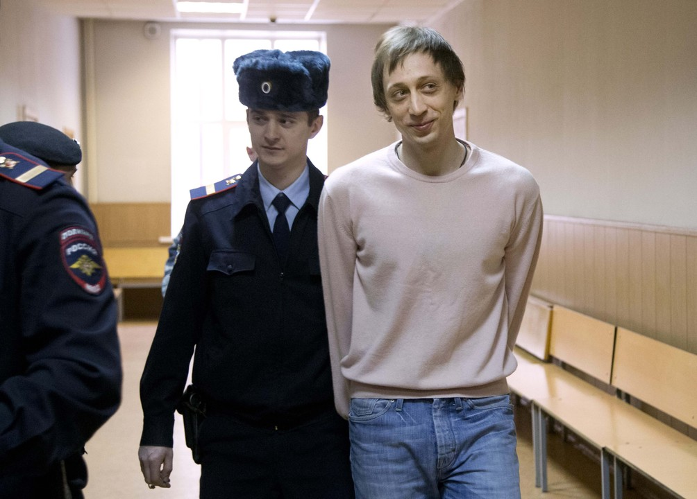 Pavel Dmitrichenko is escorted to a courtroom in Moscow Tuesday. The dancer was convicted of planning the Jan. 17 acid attack on the Bolshoi ballet's artistic director Sergei Filin.