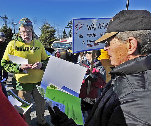 The Southern Maine Labor Council's John Newton, left, hands out literature to protesters on Black Friday last week at the Walmart in Scarborough. A letter writer praises Newton for his efforts to help volunteers plant new ideas in people's minds.
