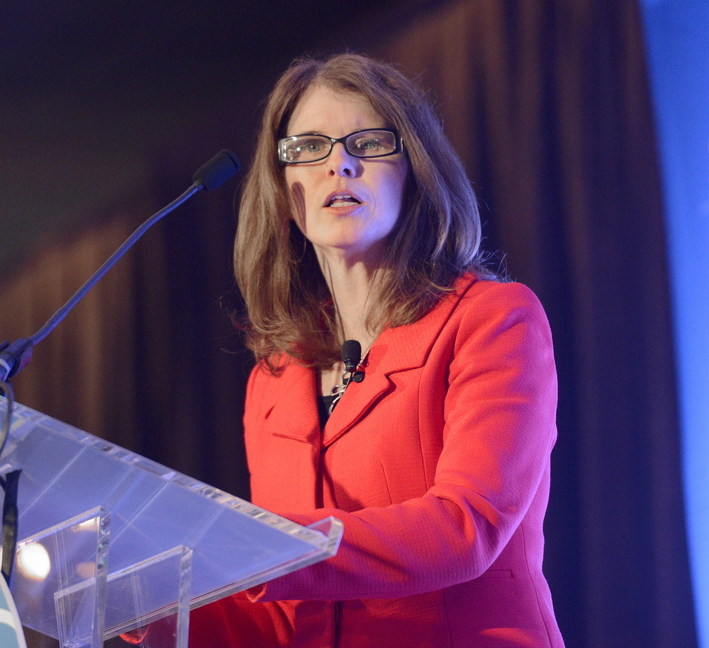 Mary Mayhew, commissioner of the Maine Department of Health and Human Services, speaks at the Portland Chamber's Eggs and Issues breakfast at Holiday Inn By the Bay in Portland Wednesday.