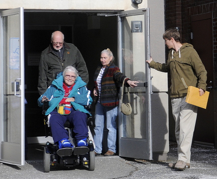Religious and union leaders from Kennebec County emerge after a meeting with Stefanie Nadeau of MaineCare Services in Augusta Wednesday after meeting with her about medical ride problems.