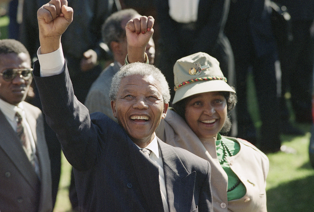 Nelson Mandela, newly elected as president of South Africa, and his wife, Winnie, greet the crowd on July 7, 1991, after arriving at a rally and a weeklong national African National Congressconference held inside South Africa for the first time in 30 years. Mandela has died at age 95.