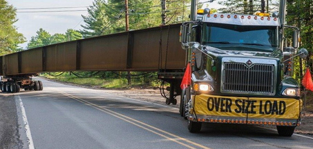 ARC Enterprises, a manufacturer of steel bridge beams in Kingfield is delivering shipments of sheets of steel, some as large as 85 feet long by 10 feet wide, via truck from South Portland, a distance of 90 miles.