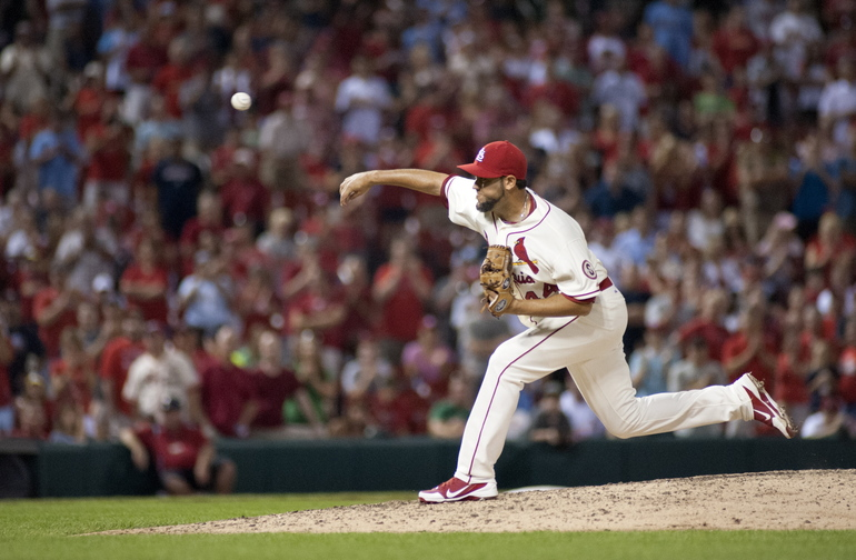 St. Louis Cardinals relief pitcher Edward Mujica throws during the ninth inning of an August baseball game against the Atlanta Braves. A person familiar with the deal tells The Associated Press that the Boston Red Sox and reliever Edward Mujica have agreed on a two-year contract.