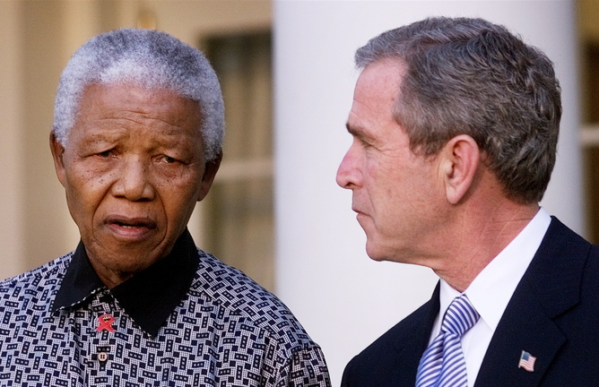 Presdient Bush, right, listens to former South African President Nelson Mandela speak with reporters, Monday, Nov. 12, 2001, in the Rose Garden, after the two met to review Mandela's ongoing effort to bolster peace in Burundi. Bush commented about the American Airlines jetliner that was on its way to the Dominican Republic with 255 people aboard when it crashed moments after takeoff near New York City.