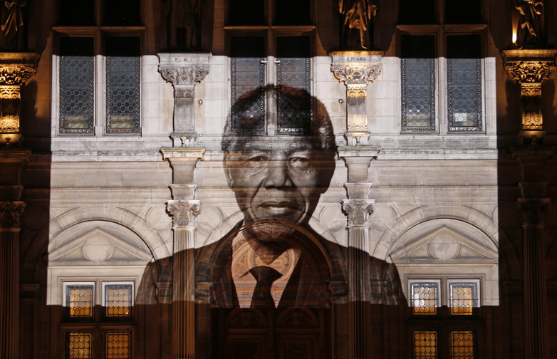 An image of late South African President Nelson Mandela is projected on the facade of Paris town hall Friday, as leaders around the world paid tribute to the anti-apartheid hero.