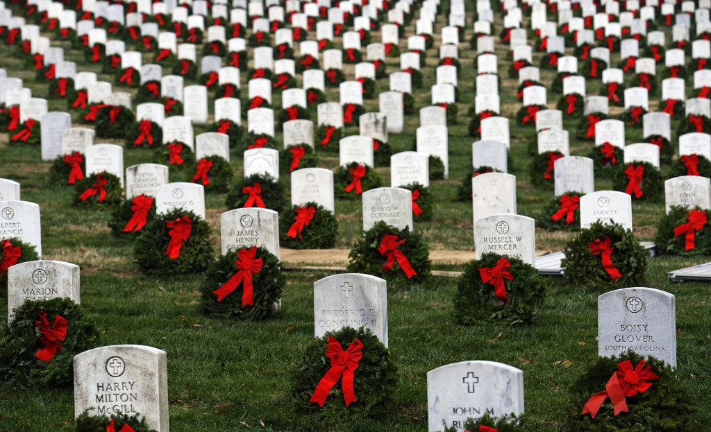 Wreaths from Worcester Wreath Co. of Harrington grace headstones in Arlington National Cemetery in Arlington, Va., in 2011. Despite possibly scaling back this year's shipment, the wreath maker has big plans for next year.