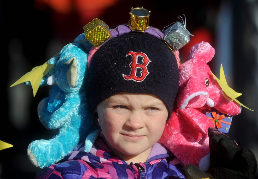 Madissynn Sutton, 7, wears a pair of stuffed elephant earmuffs at the annual Chester Greenwood Day parade in downtown Farmington on Saturday.