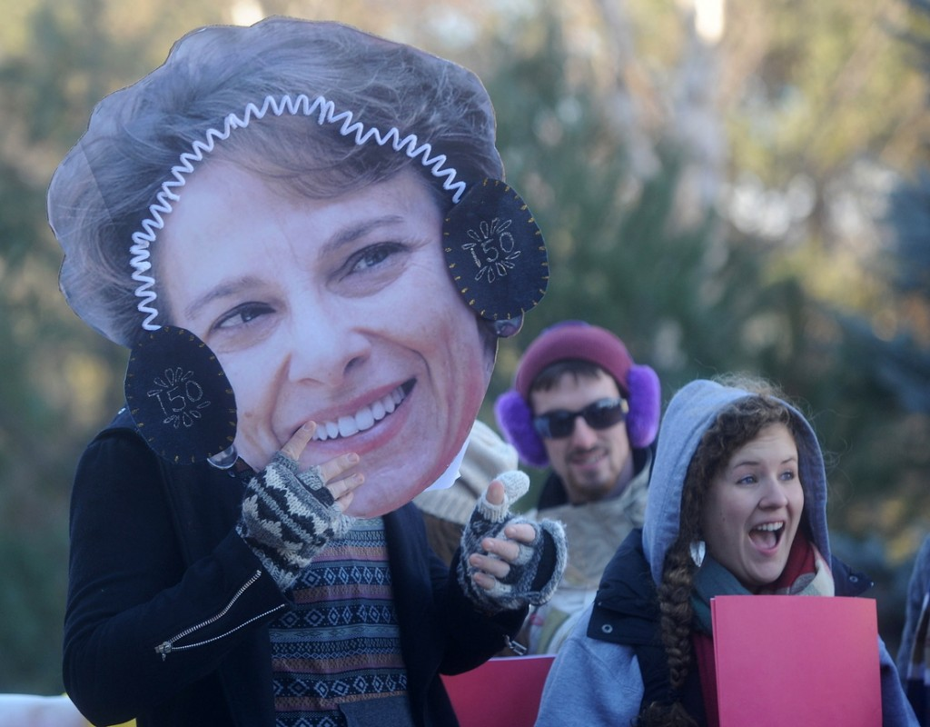James Maloney-Hakins, 21, holds a cut-out of University of Maine at Farmington President Kate Foster on the Alpha Lambda Delta float before the annual Chester Greenwood Day parade in downtown Farmington on Saturday.