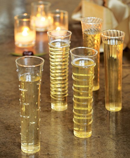 Champagne flutes from Olive & Cocoa are studded with dots, swirls and stripes.