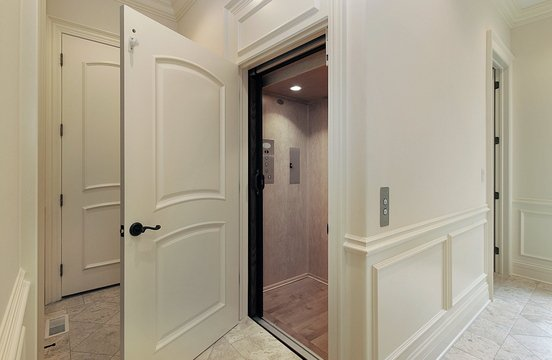 Elevators are being added to suburban mansions and to urban townhouses. Installing one costs about $25,000.