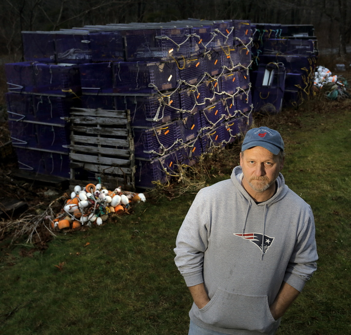 Shrimp fisherman Tim Simmons of Nobleboro stands next to the roughly 100 shrimp traps that won't be used for the 2014 season.