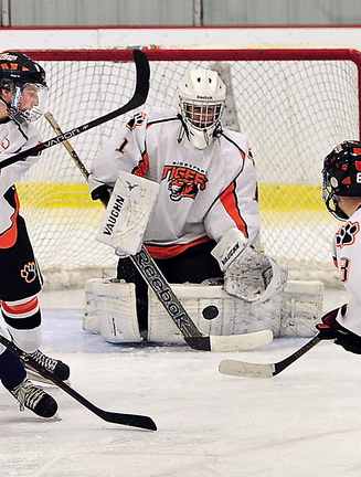 Biddeford goalie Brandon Daigle drops to his knees to make a save.