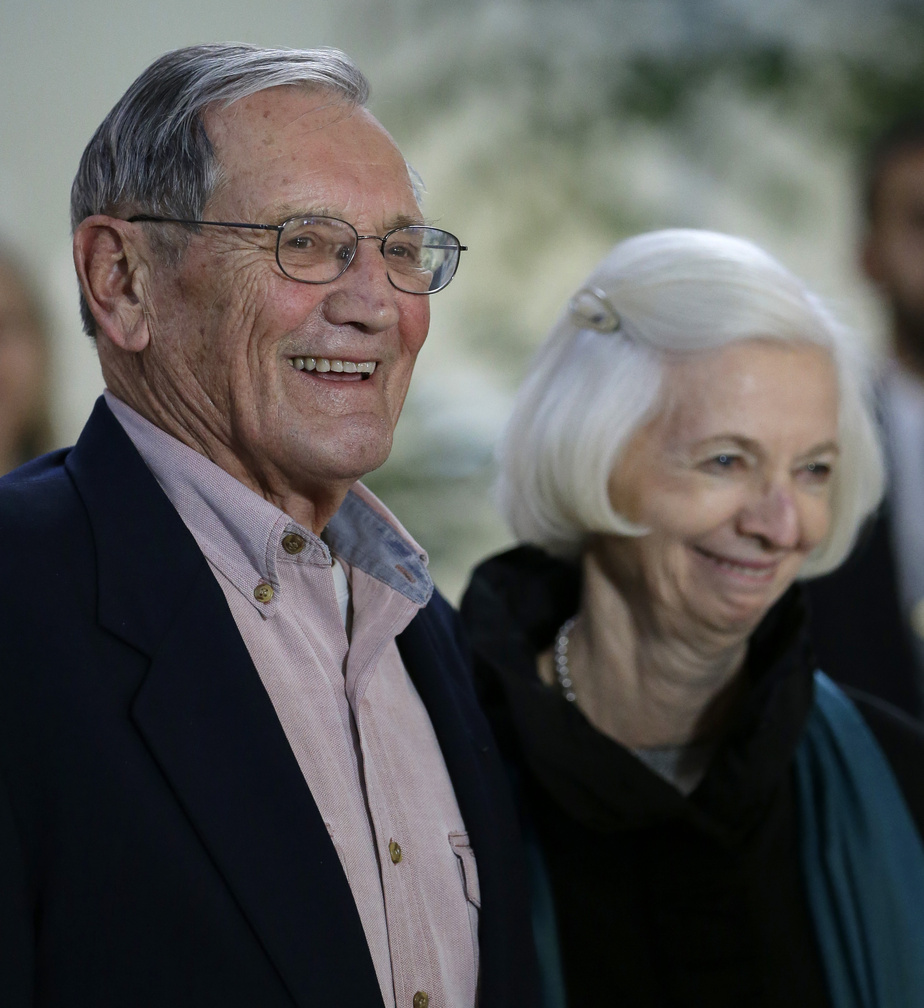 Merrill Newman speaks beside his wife, Lee, after arriving at San Francisco International Airport on Saturday. Newman was detained in North Korea in late October.
