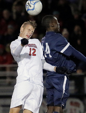 """Scarborough's Wyatt Omsberg, left, seen challenging Portland's Jonathan Bobe in the Western Class A boys' final Nov. 6, was no surprise to his coach, Mark Diaz. """"He gave us commitment,"""" Diaz said of the senior, who will attend Dartmouth next year."""