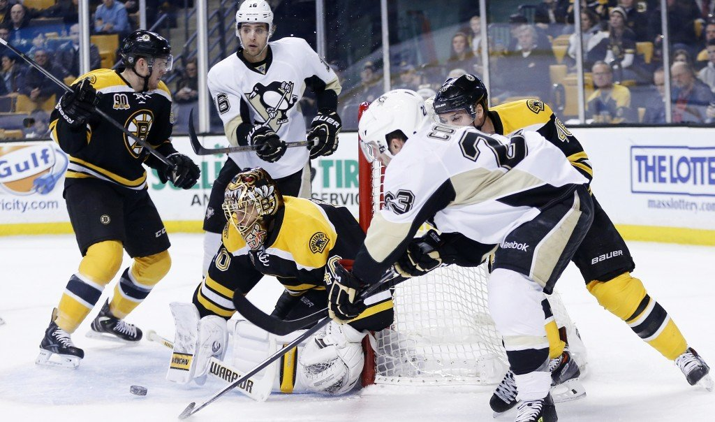 Boston goalie Tuukka Rask blocks a stuff-shot attempt by Pittsburgh's Chris Conner in the first period of the Bruins' 3-2 win over the Penguins at Boston on Saturday. Pittsburgh's Brooks Orpik was taken off the ice on a stretcher after an altercation with Boston's Shawn Thornton.