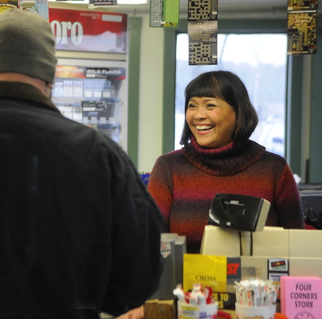 Vicky Staszewski works behind the counter at Four Corners General Store in West Gardiner on Thursday. The store's customers have donated items for Staszewski's family members in the Philippines.