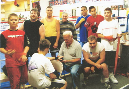 Richard Potvin with some of the young men he worked with at the Southern Maine Boxing Club.